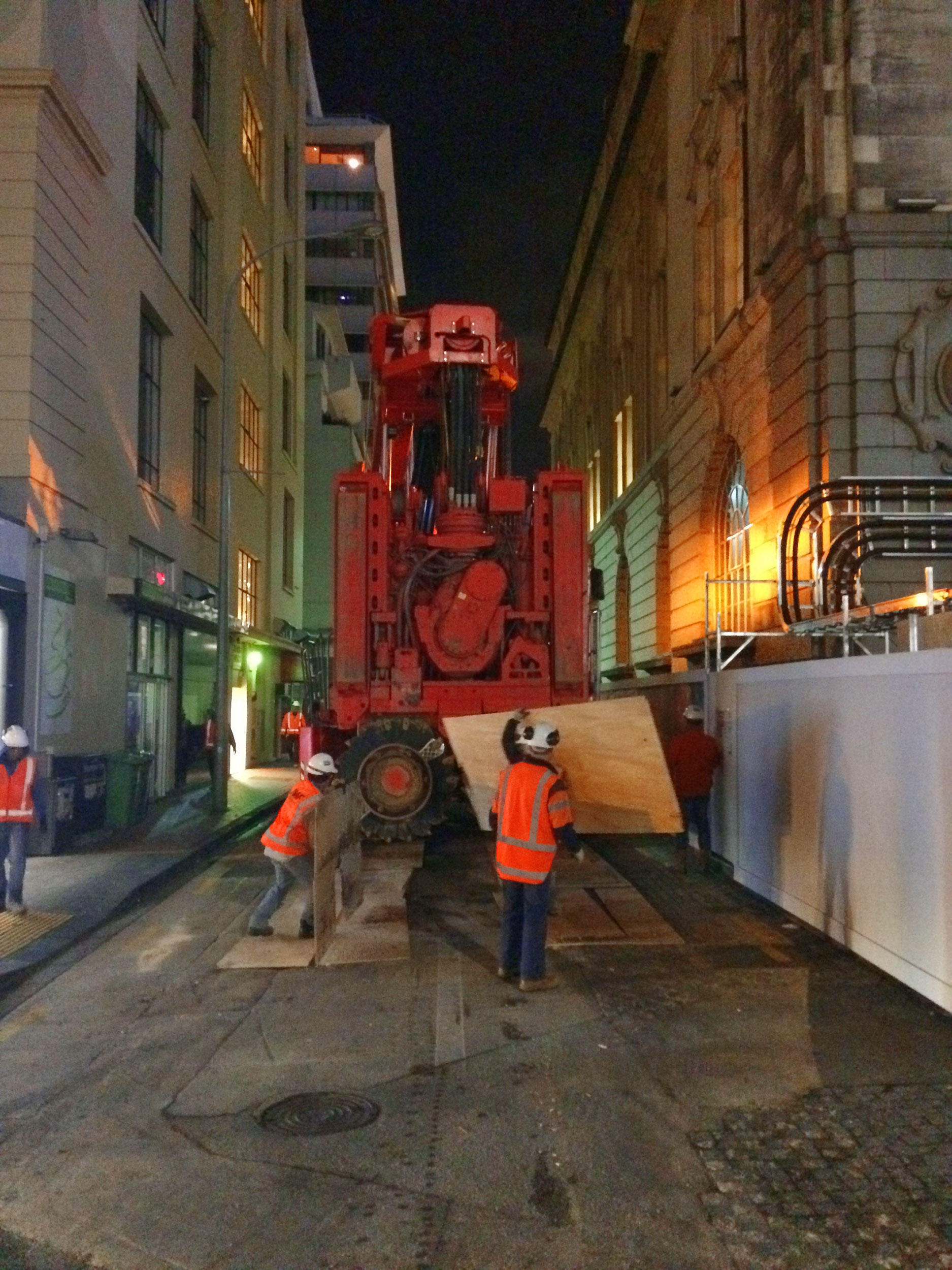 This bright red 90 tonne piling rig named Sandrine worked inside and outside the historic Chief Post Office (Britomart Transport Centre) building until being returned to France in early 2018.