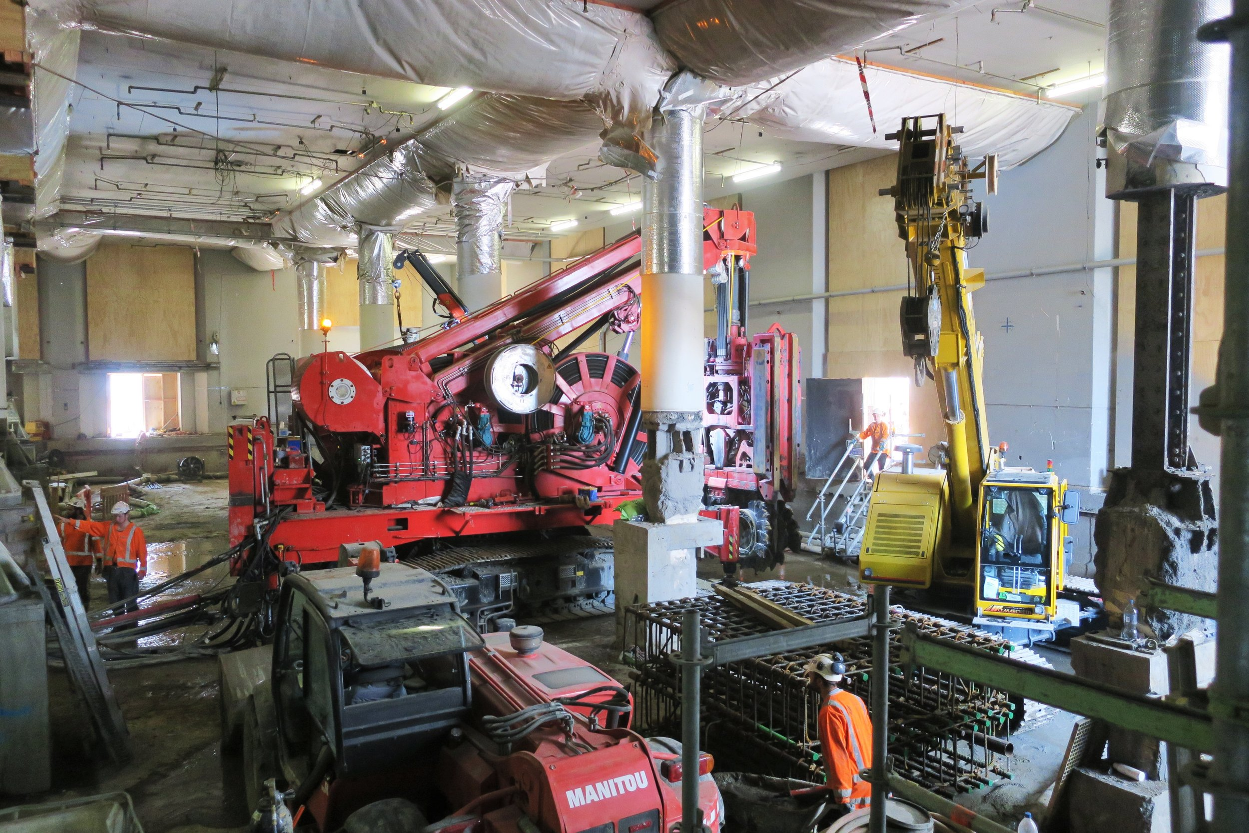 Inside the CRL construction in the Chief Post Office January 2018.This bright red 90 tonne piling rig named Sandrine worked inside and outside the historic Chief Post Office (Britomart Transport Centre) building until being returned to France in early 2018.