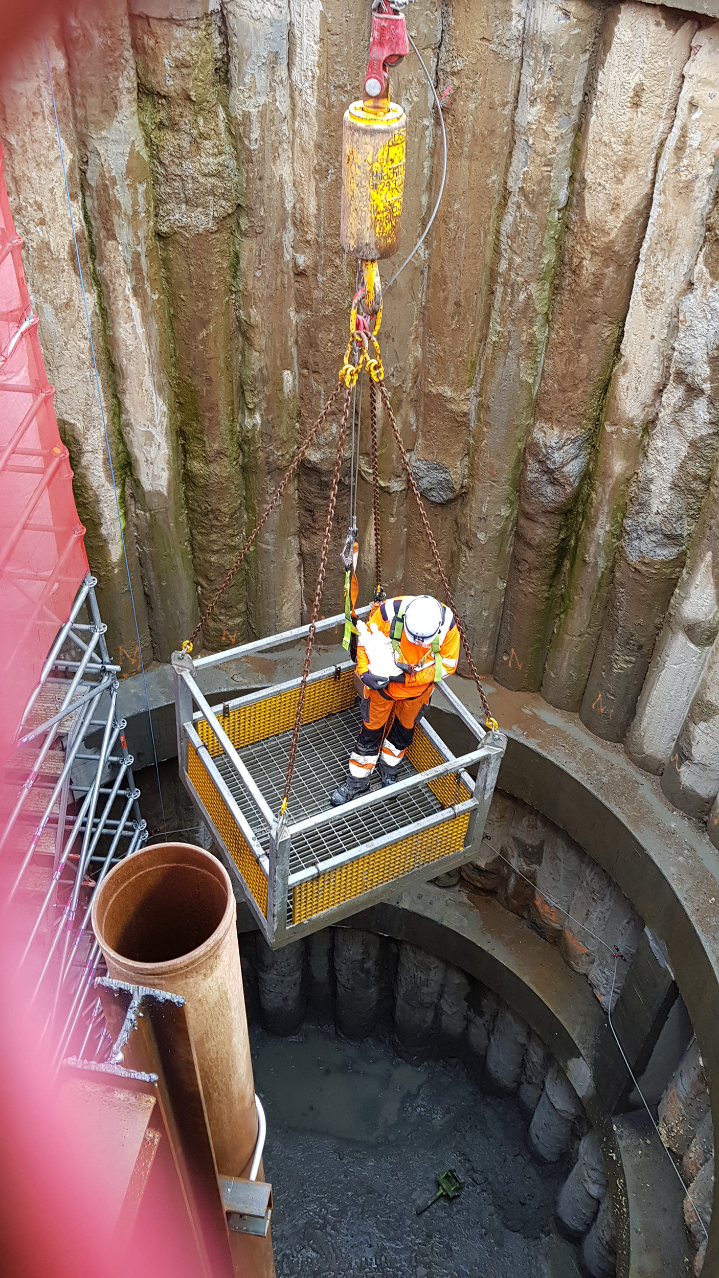Statuette of St Barbara, the patron saint of miners and tunnellers is carried by MBJV tunnel supervisor Laurent LeCalvez down the CRL shaft at Mt Eden where tunnel boring machine Jeffie will be used to help divert a section of the existing Mt Eden stormwater pipe, which will be in the way of the CRL tunnel.