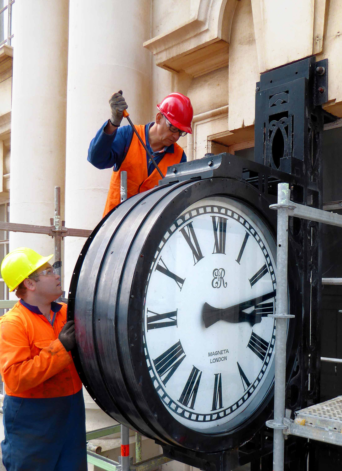 CLOCK: The CPO clock being carefully removed for restoration