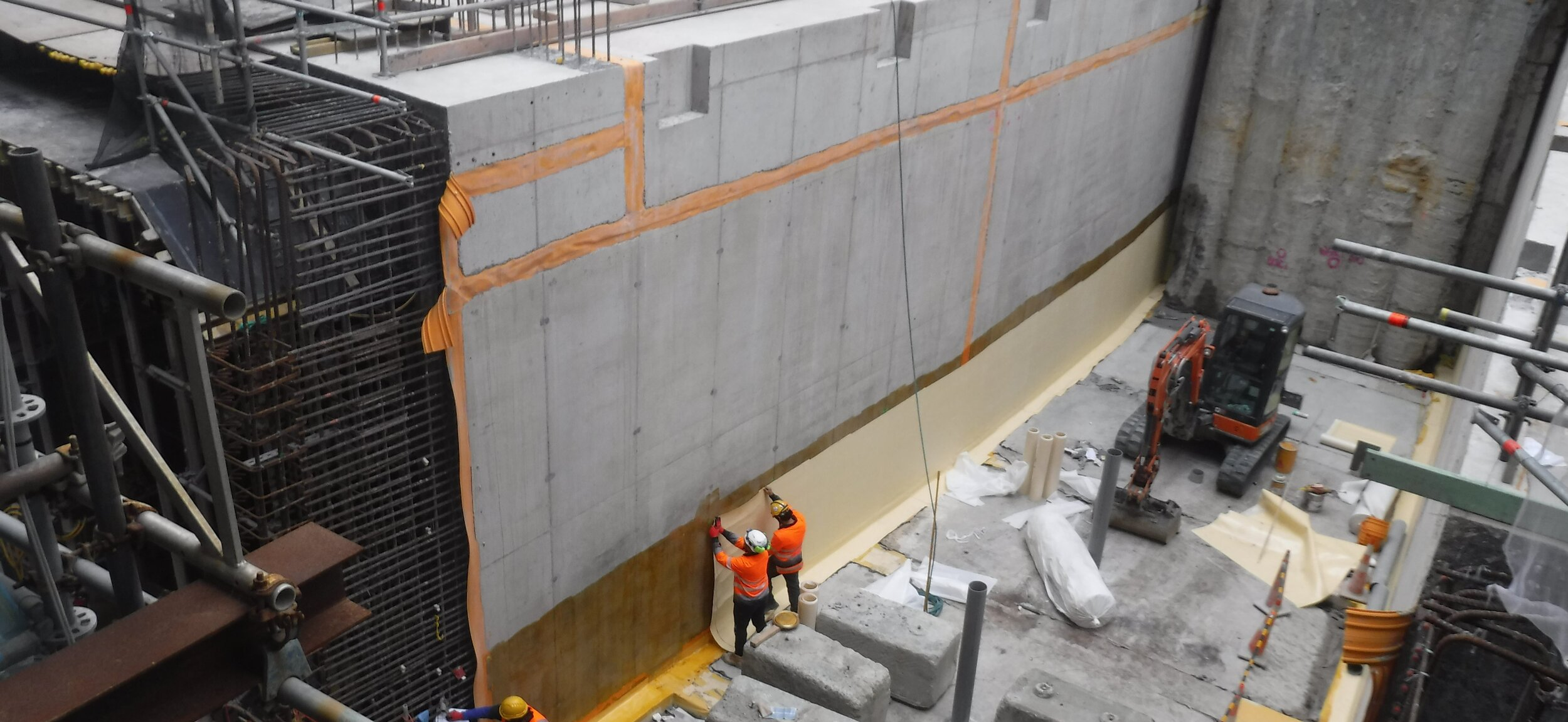 TUNNEL: Workers apply waterproof membrane to one of the tunnel walls built in front of the Chief Post Office in lower Queen Street