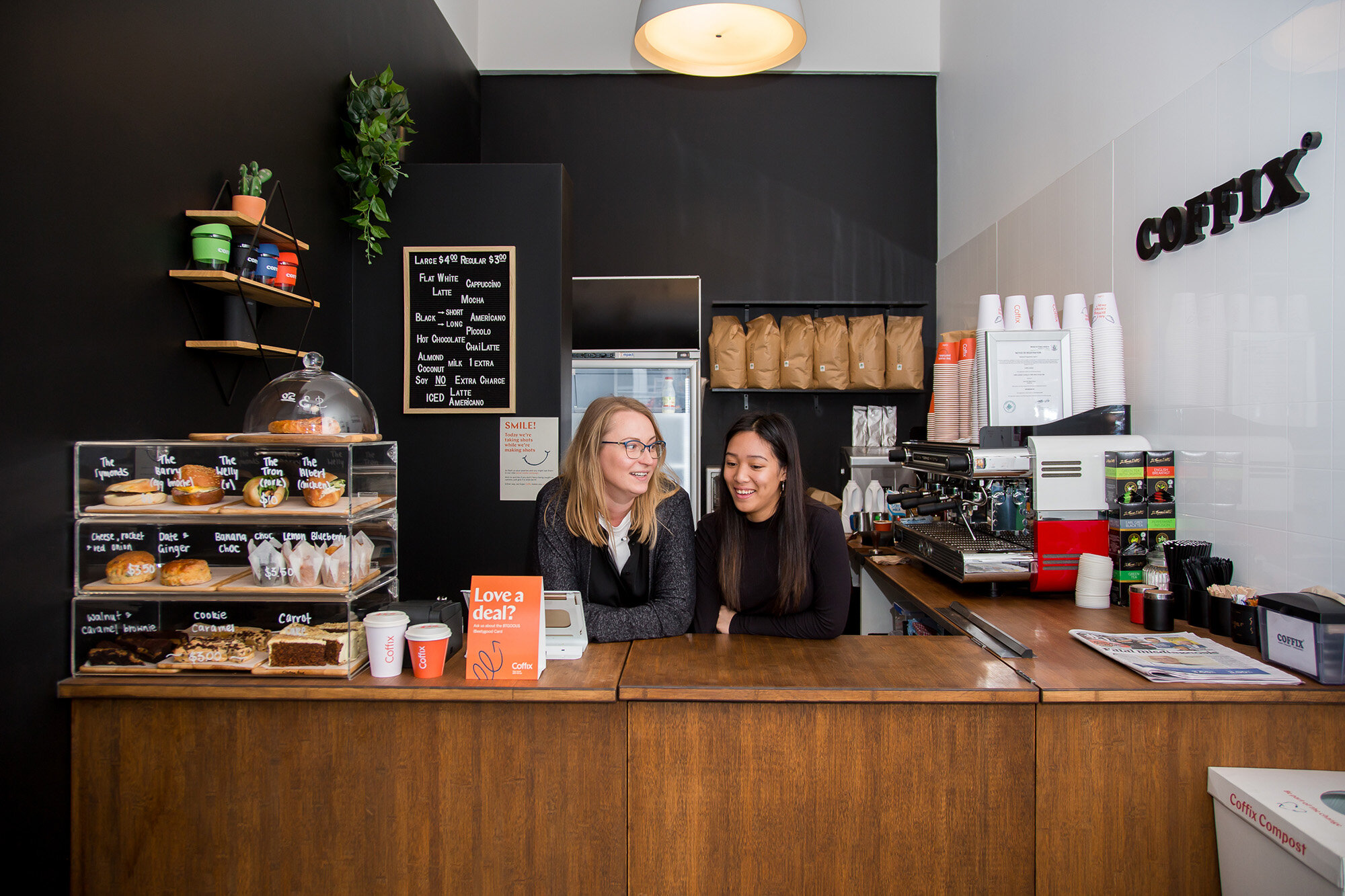 Kate (left) knows most of her regulars' coffee orders by heart.