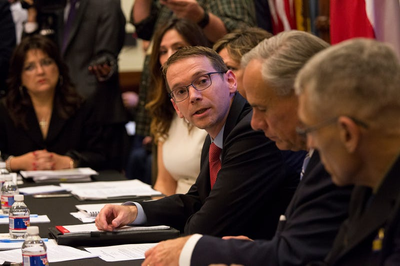 """The State Auditor's Office on Tuesday criticized the Texas Education Agency's handling of two multi-million-dollar contracts -- one, affecting special education students. Commissioner Mike Morath, center, shown during a May roundtable on school safety at the Texas Capitol, said he's launched a """"a top-to-bottom review of contract processes. (Ana Ramirez/AP)"""