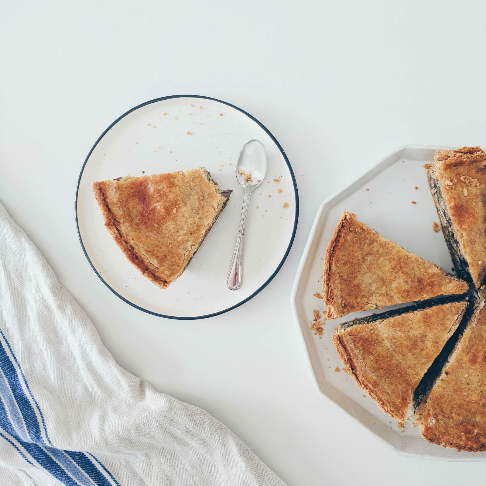 Slice after slice of torta salata (savoury pie) with mushroom and blueberry.