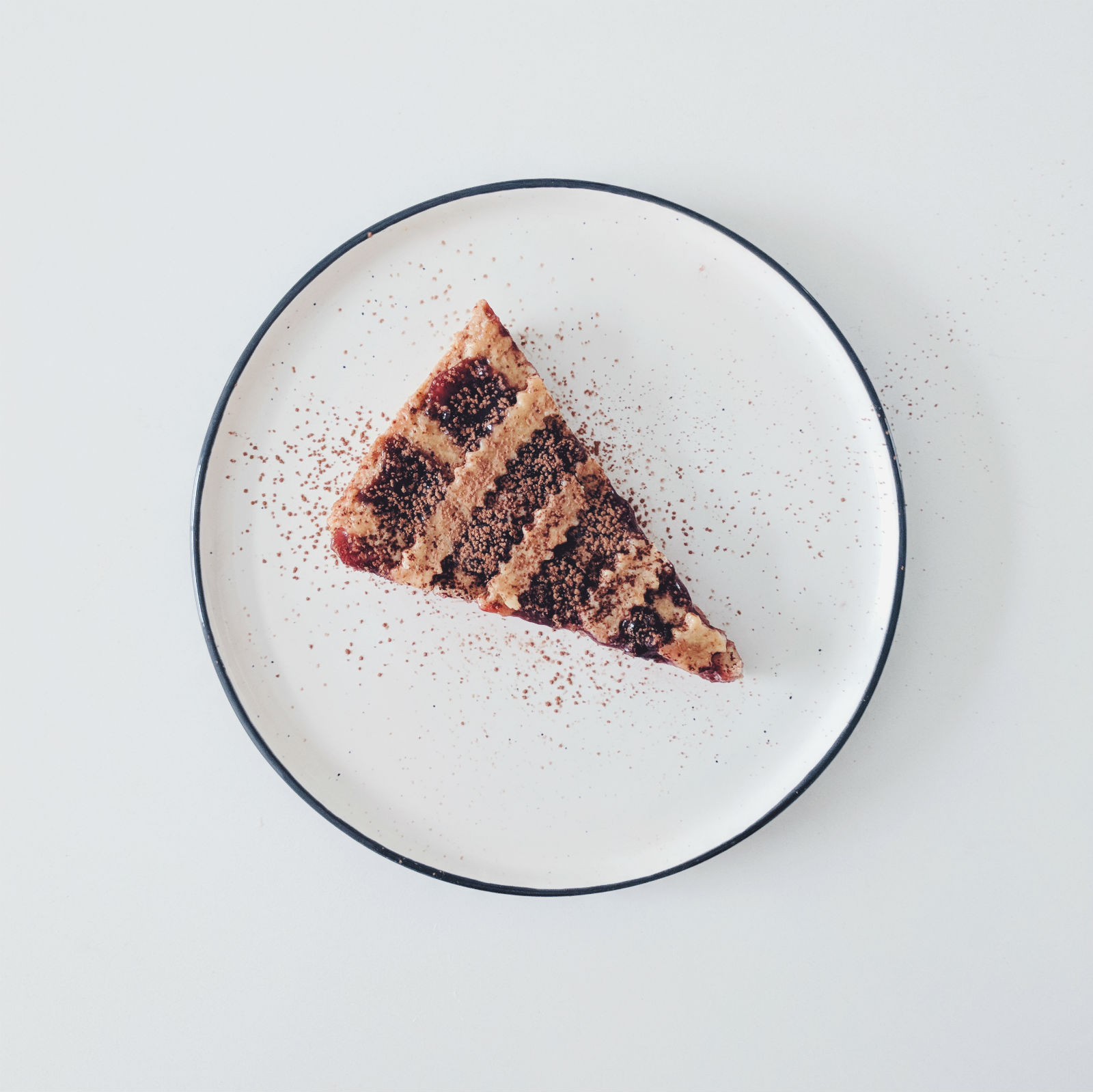 Crostata di marmellata (jam tart) with a dusting of cacao.