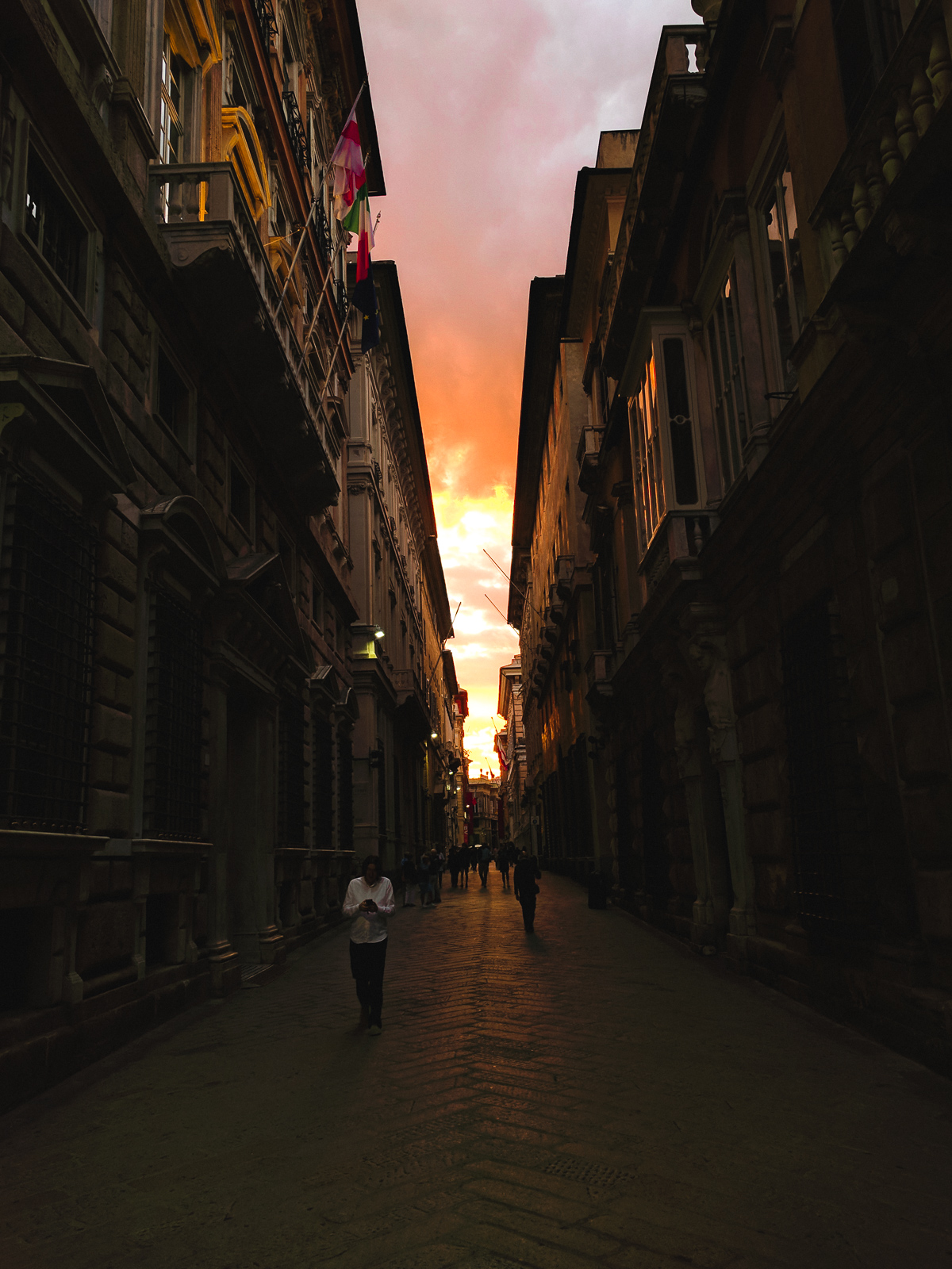 Via Garibaldi in Genoa at sunset.