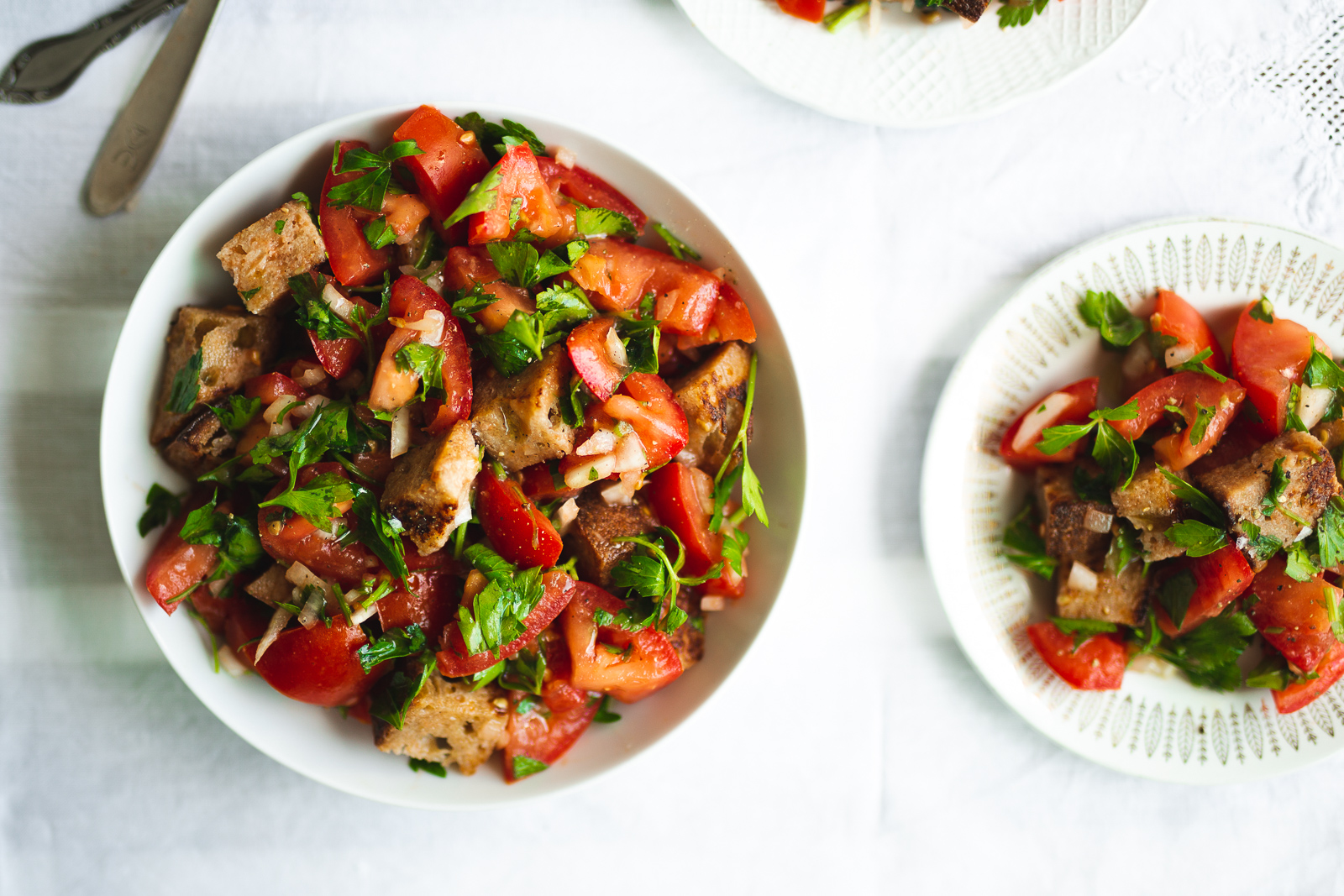 Panzanella: a Tuscan tomato and bread salad with onion and fresh parsley.