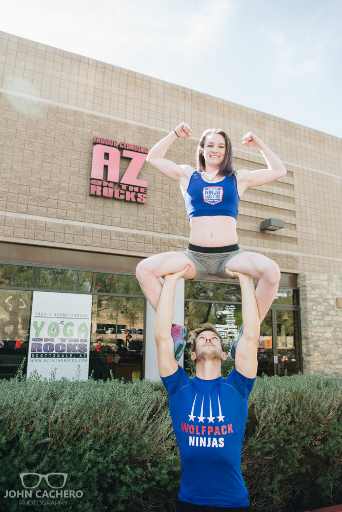 Ninja warriors, Brittany Hanks and Nicholas Coolridge, showing off some skills outside.