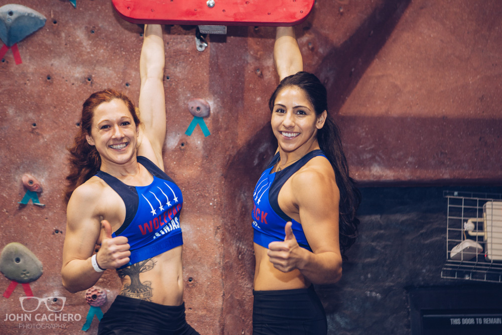 Ninja warriors, Jeri D'Aurelio and Tiana Webberley, posing on the flying wingnuts obstacle.