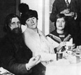 Rasputin with a female admirer (center) and his daughter Maria (right)