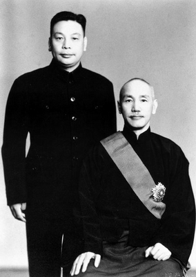 Chiang Kai-shek (seated) and his eldest son and heir Chiang Ching-kuo.