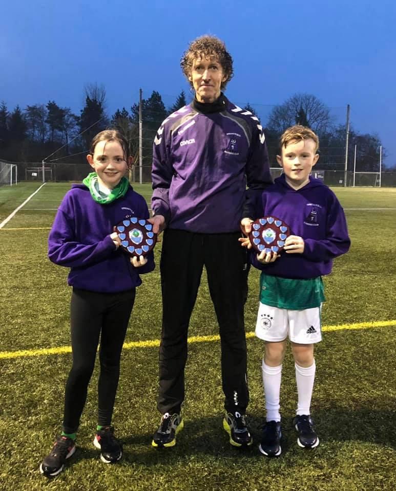 Eobha McAllister and Ethan Buchanan receive their awards from Alistair Bratten