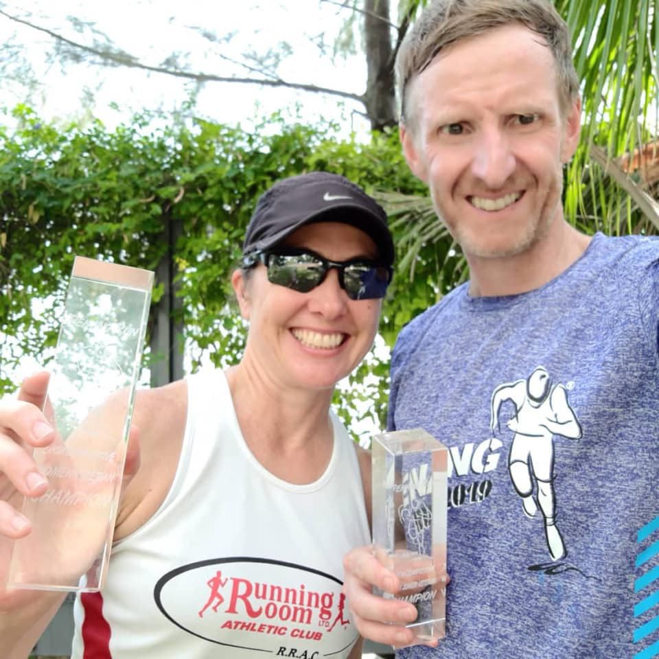 America Aznar and Simon Stewart with their trophies at the Penang Run Half Marathon