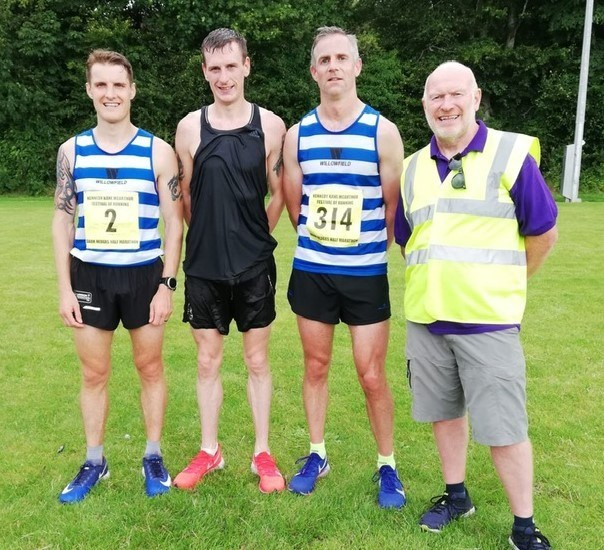 Aaron Woodman, Eoin Hughes and David Neill with Race Director Kenneth Bacon