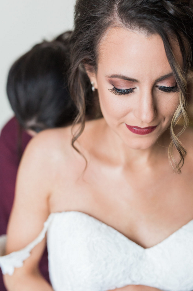 Getting Ready in Bridal Suit | Maroon and Navy Rustic Winter Wedding in Fort Worth, TX