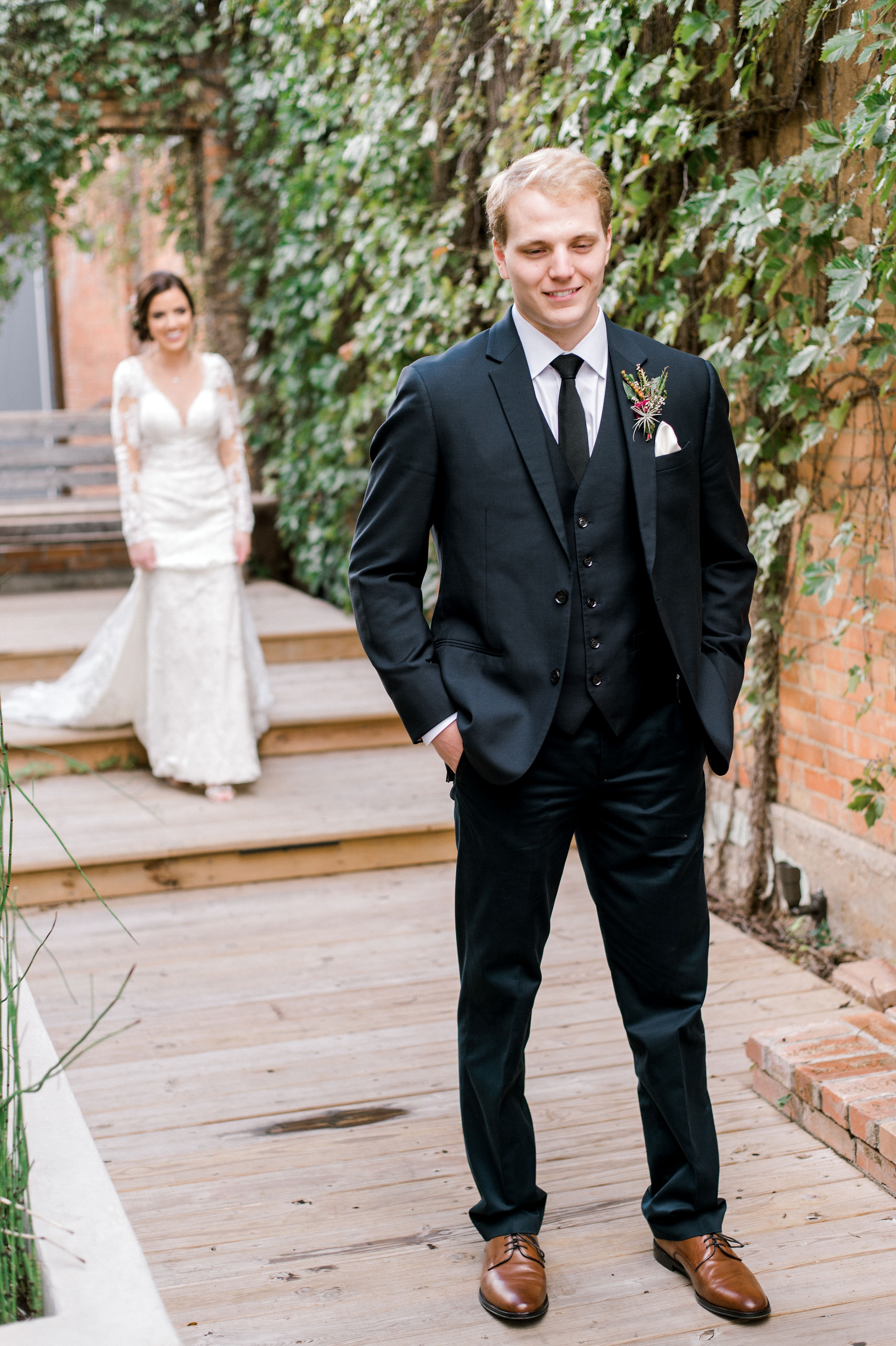 Bride and Groom First Look Photos | Industrial Vintage Wedding Reception in Downtown Fort Worth