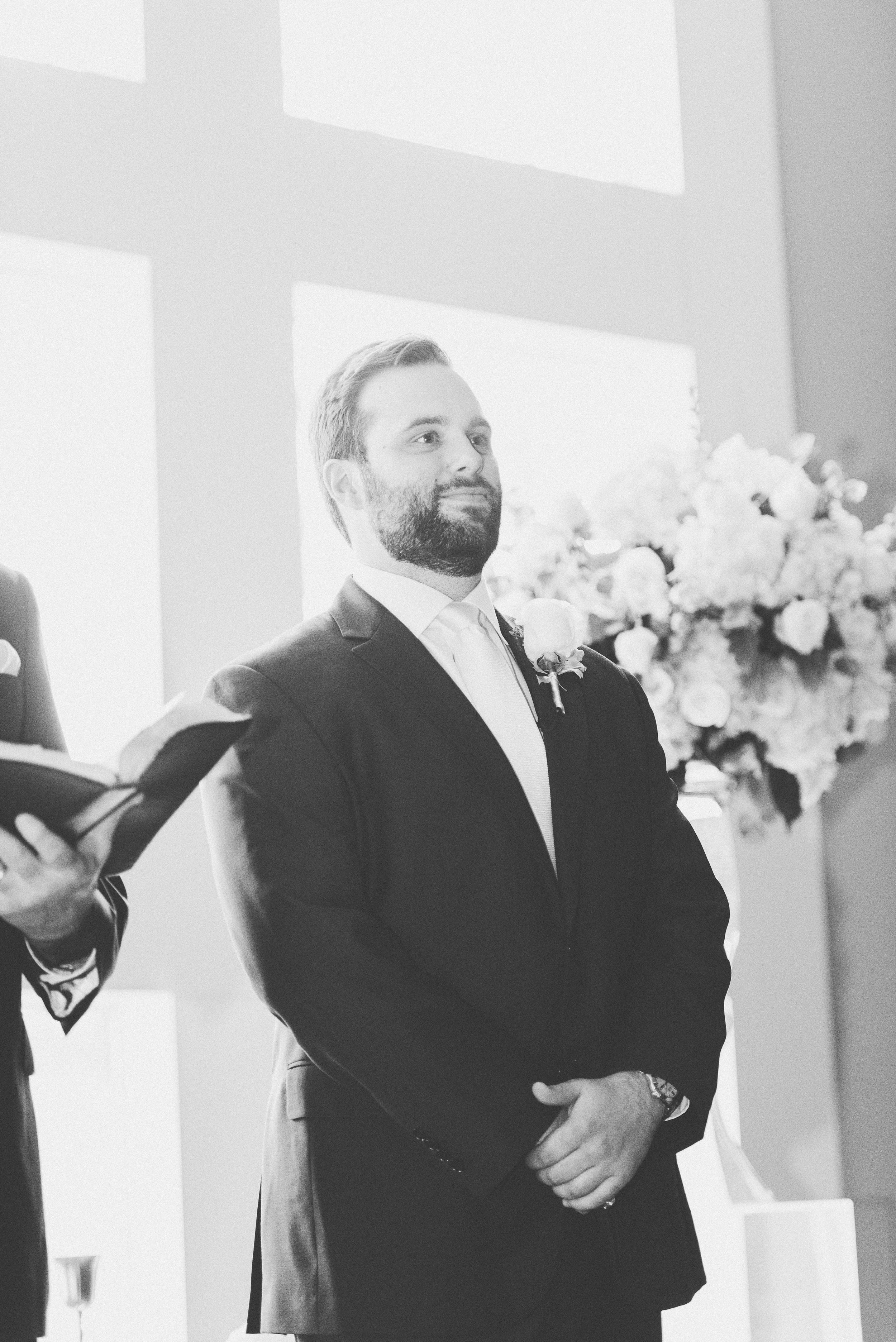Shot of Groom Waiting at the Altar | Rose Gold and Dusty Blue Winter Wedding in Dallas, TX