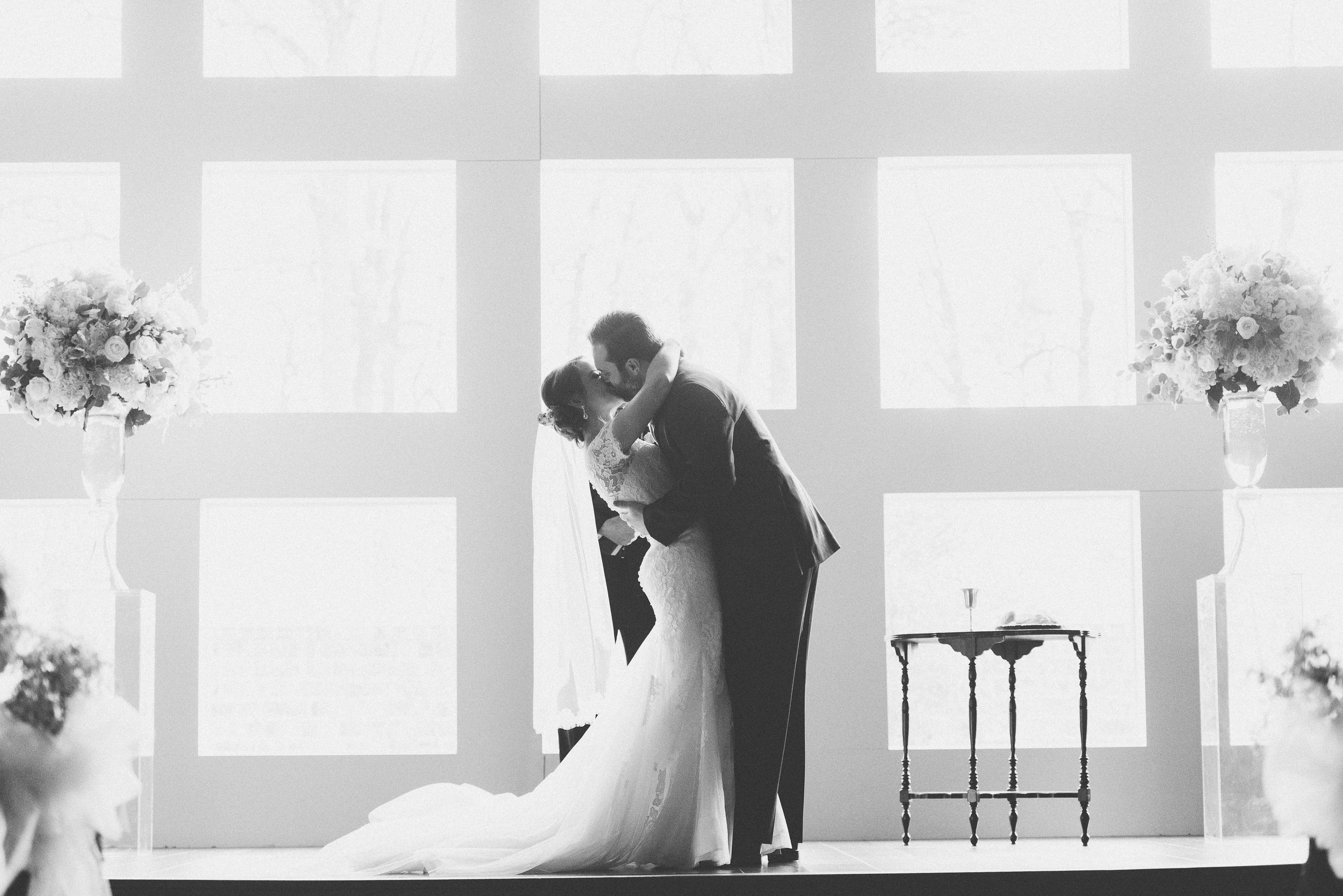 First Kiss as Bride and Groom | Rose Gold and Dusty Blue Winter Wedding in Dallas, TX