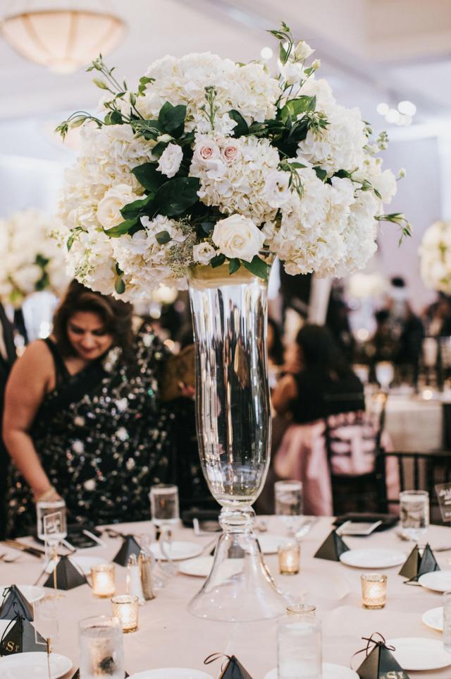 Formal Downtown Dallas Wedding Reception | Ballroom White Floral Arrangment