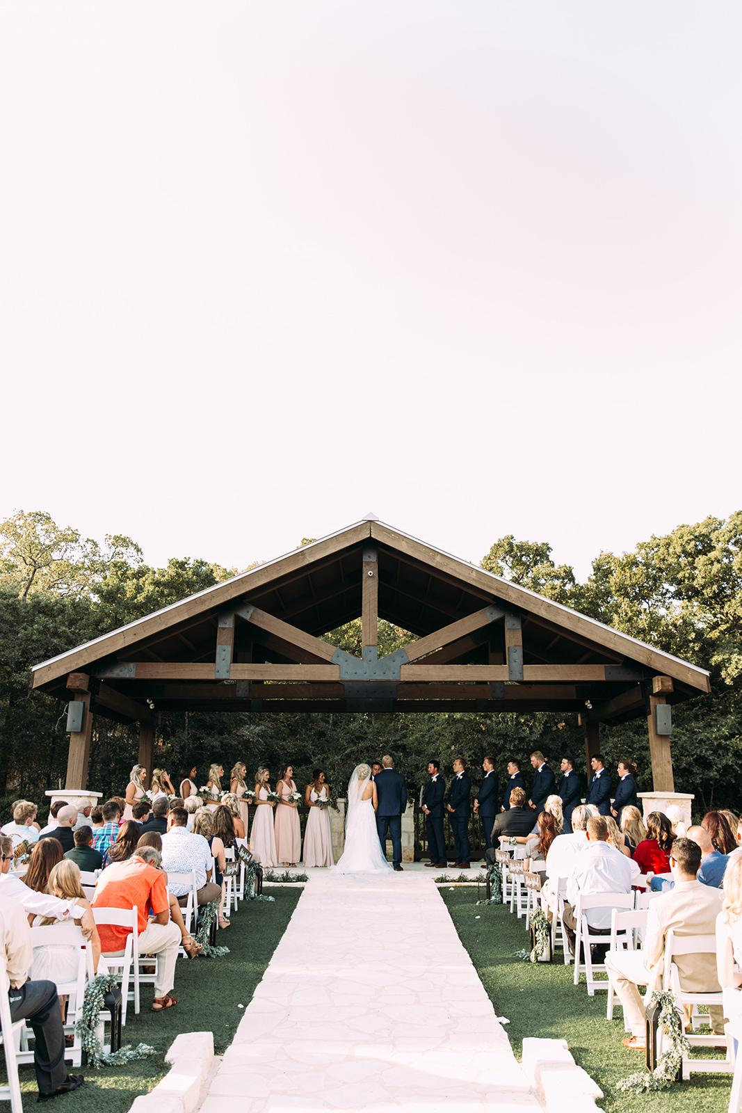 rustic outdoor summer wedding ceremony