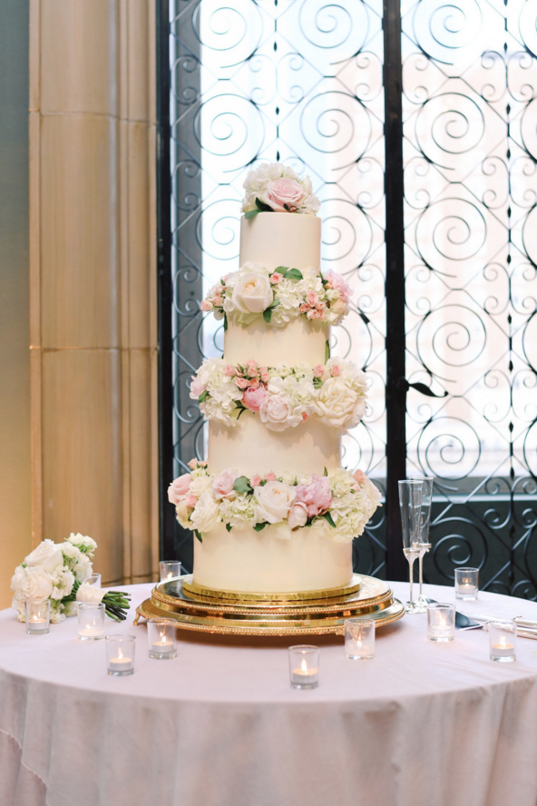 classic white and pink wedding cake.png
