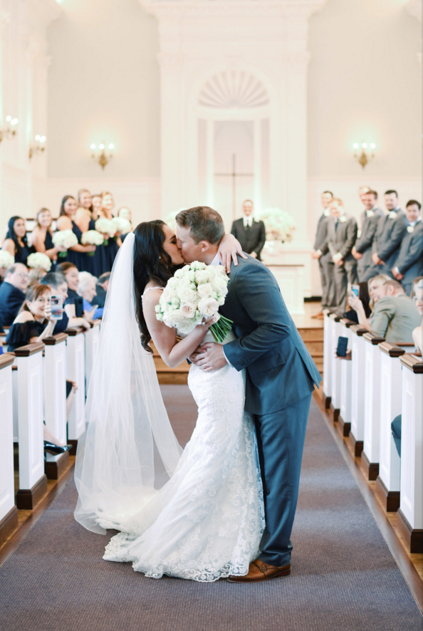bride and groom ceremony kiss.png