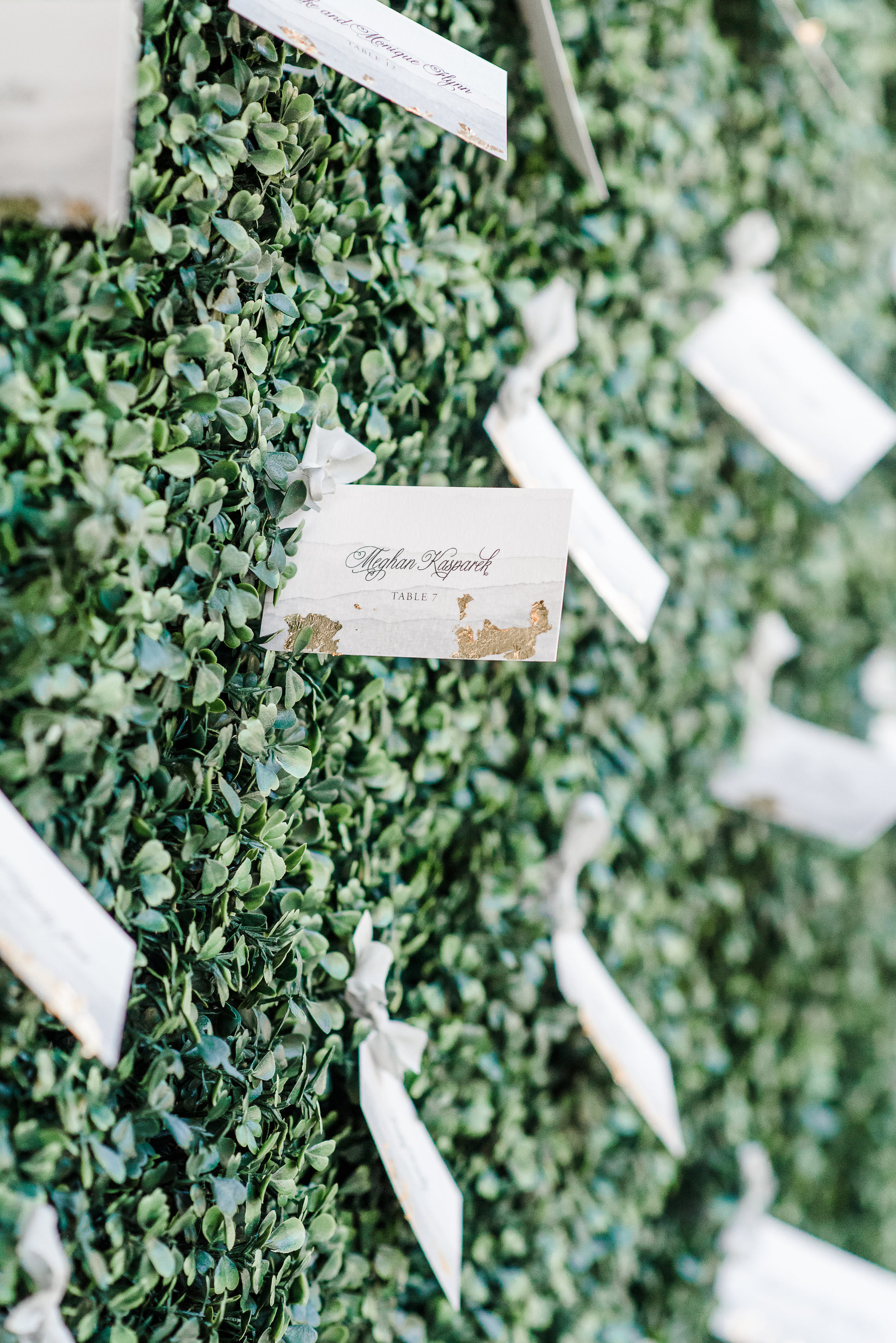 ribbon tied escort cards with gold foil