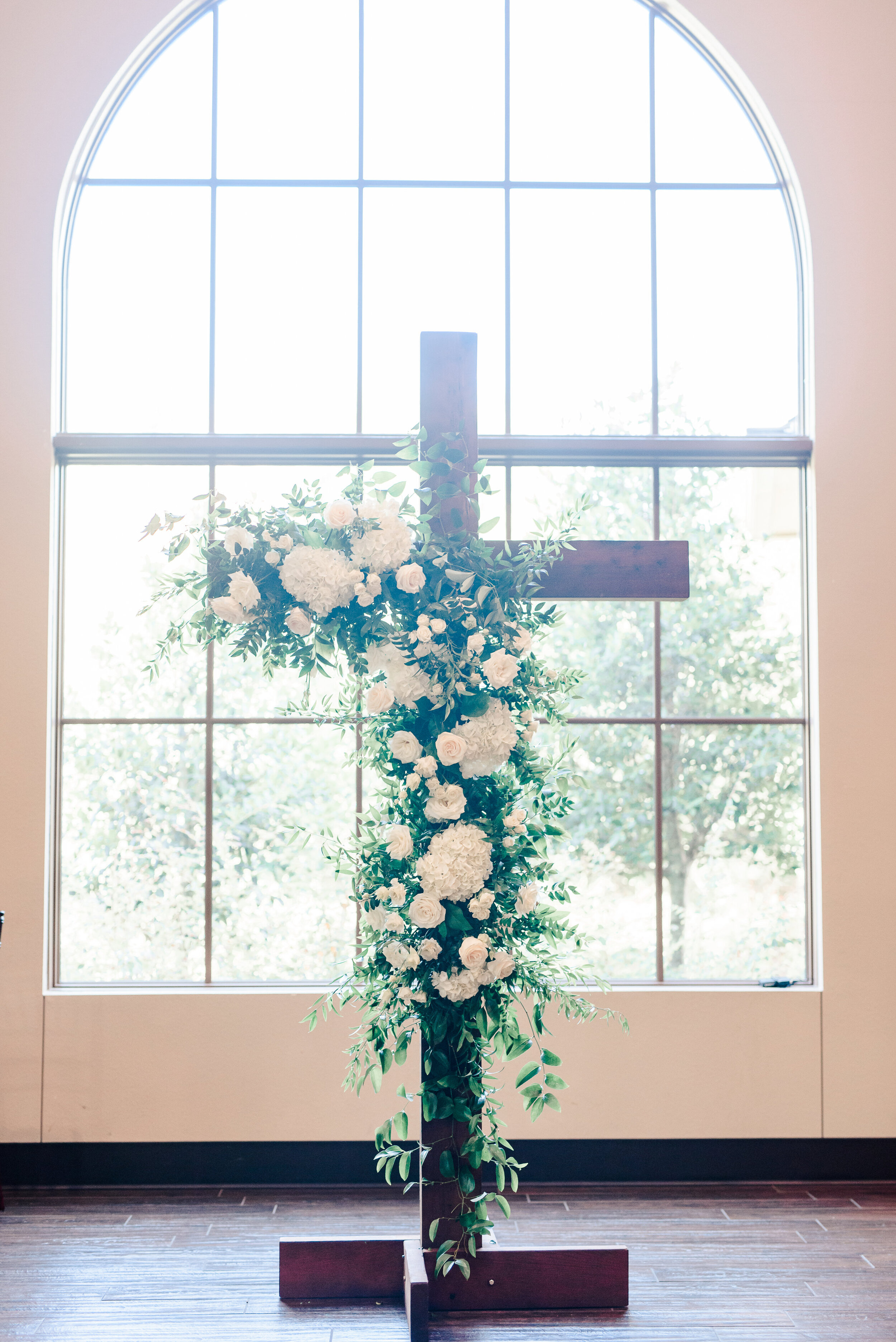 ceremony cross with flowers
