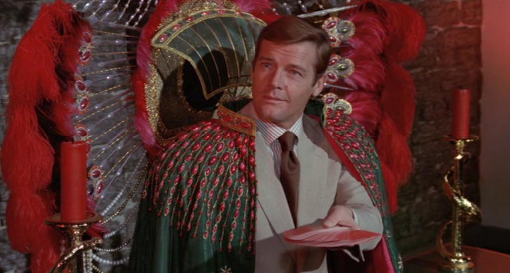 Roger Moore sitting in the Tarot throne from   Live and Let Die