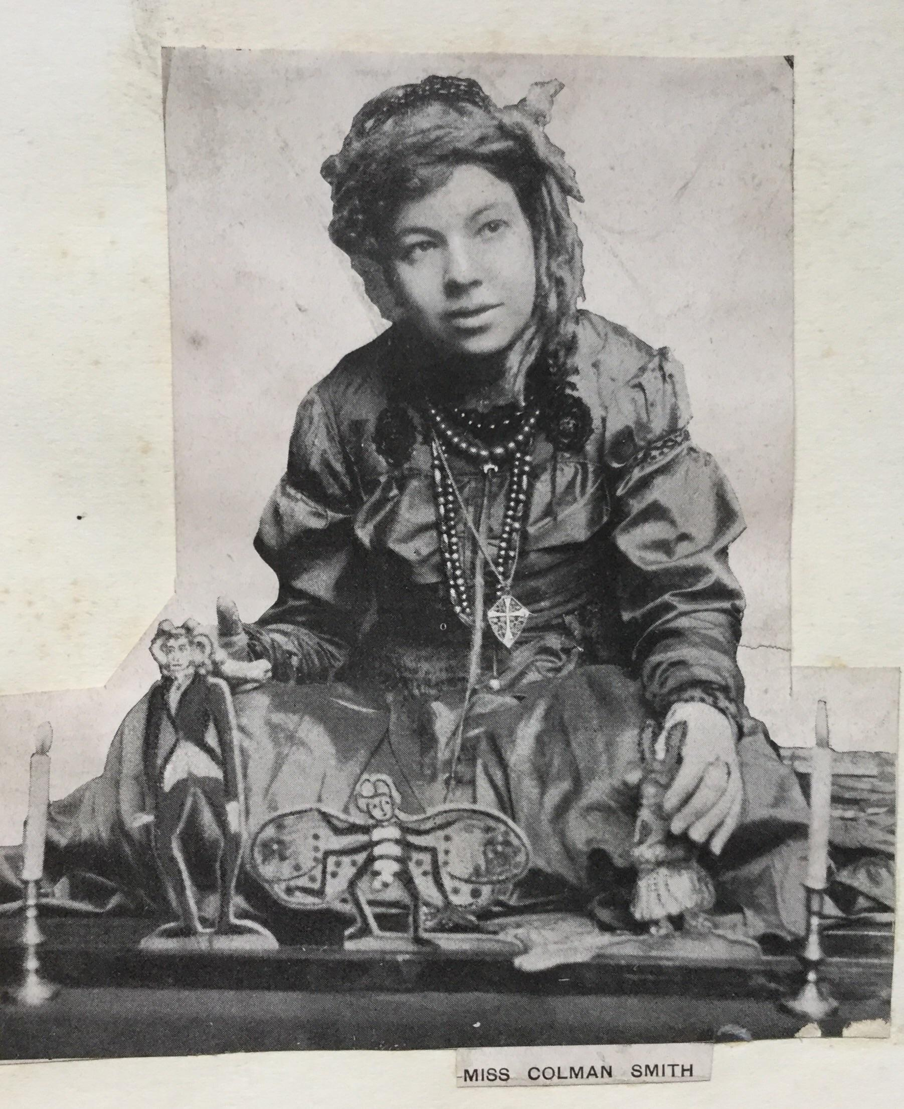 "Pamela Colman Smith with some of the simple wooden dolls she used for telling her ""Annancy Stories."""