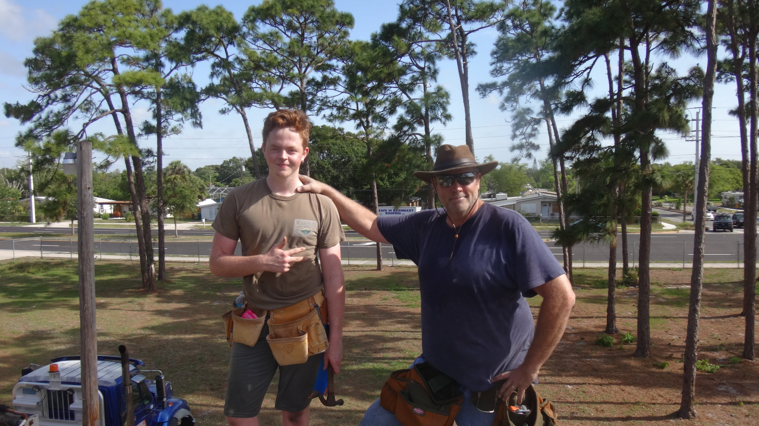Dan Walton and his son, Matthew on the job