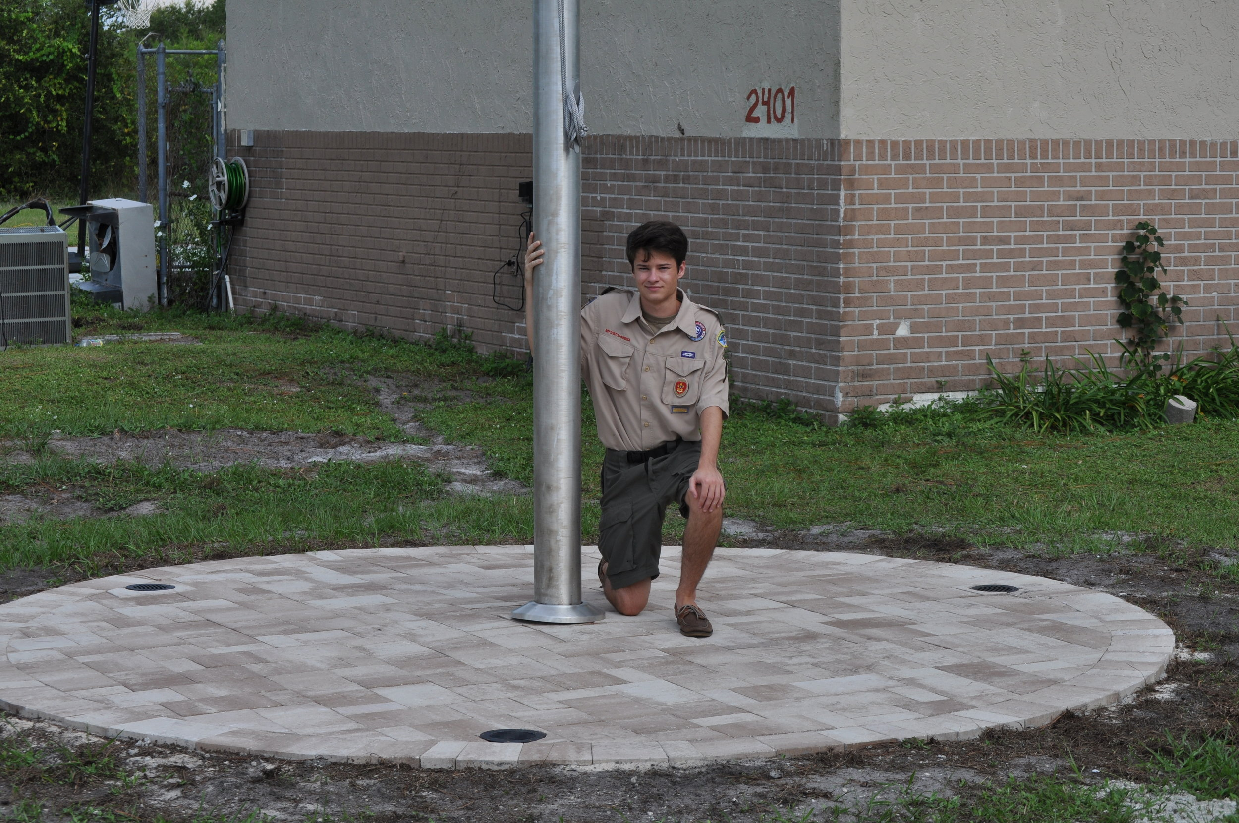 One of our scouts, Zachary Zaroogian, has completed his Eagle Project, which was to install a 30' flag pole at the Scoutpost!