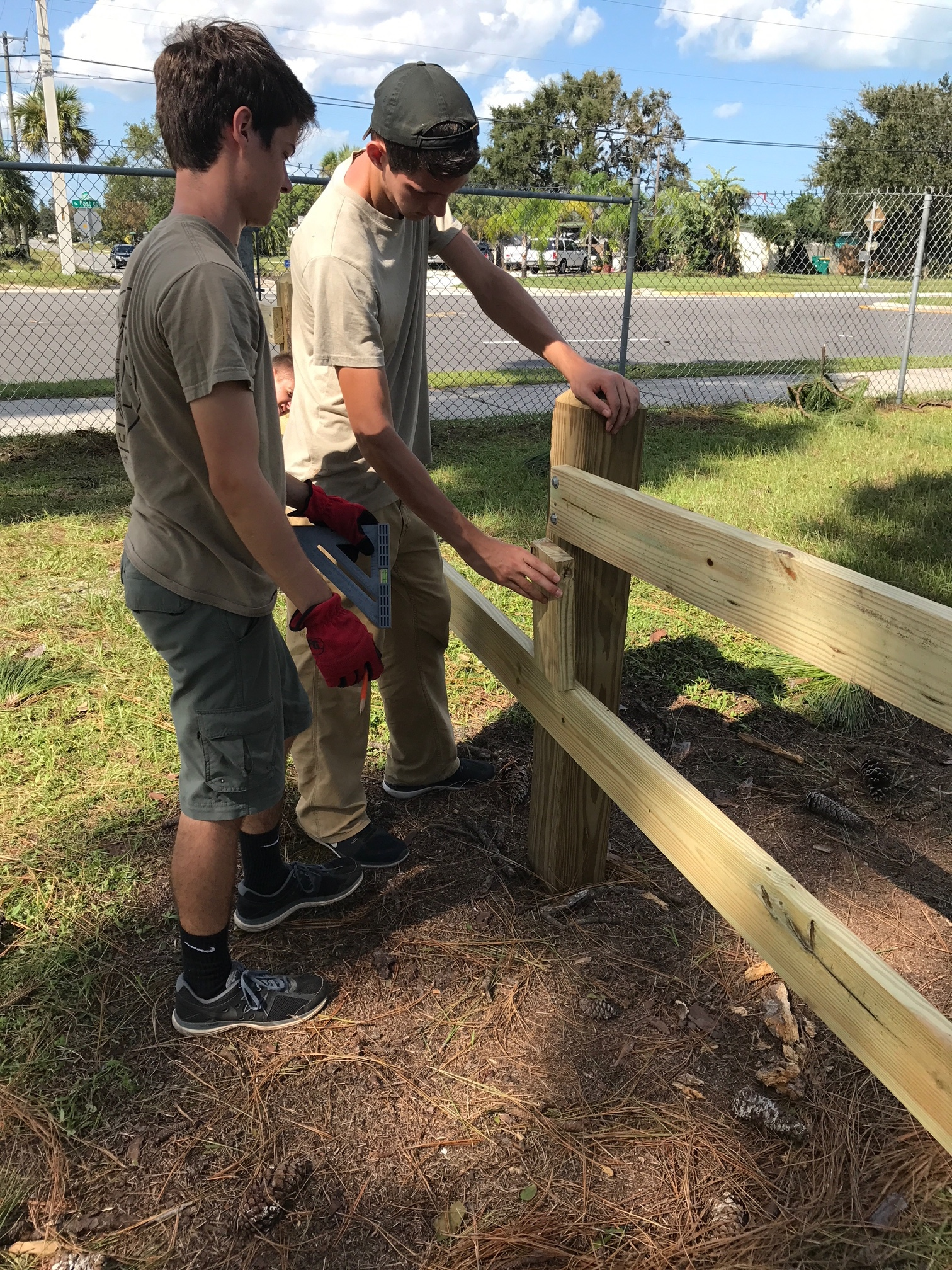 The fence was constructed using treated 6x6 posts, decoratively trimmed, treated 2x7 quality lumber, and weather-proof robust hardware.