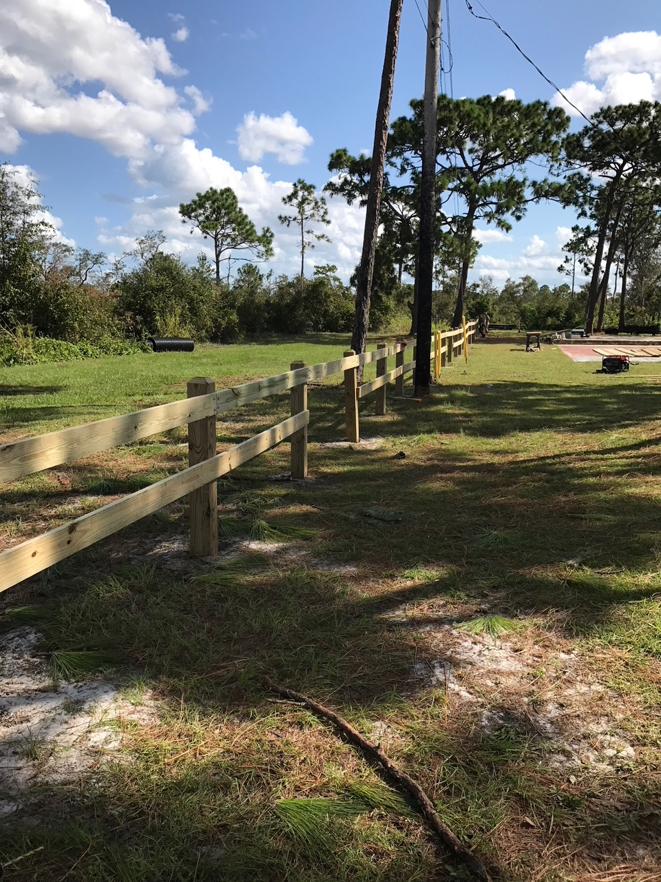 The fence spans the East Side of our property and serves as a decorative delineation between our property and the adjacent Wickham Park woods.   An opening was left to allow people to freely pass both ways.