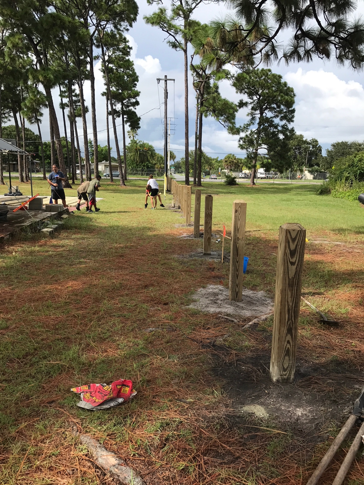 Posts were cemented in for stability (it already made it through Irma).   The fence-line was canted up and down to match the hills and valleys as it moved along.
