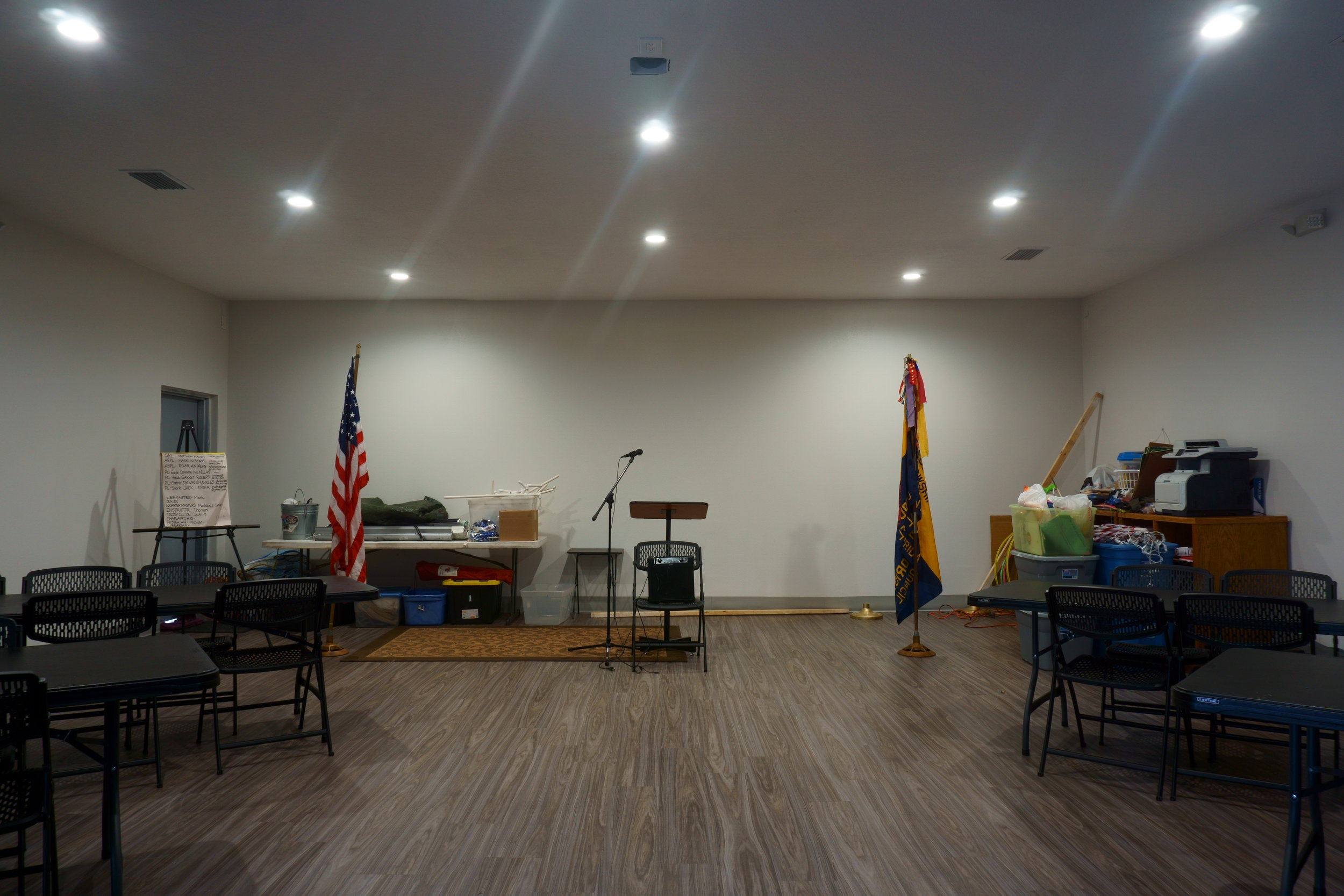 This is a shot of the front stage area with brand-new donated tables and chairs. Our Boy Scout Troop and Cub Scout Pack are now having meetings in here! Everything is new… electrical, lighting, plumbing, sewage, roof, drywall, ceiling, and flooring!