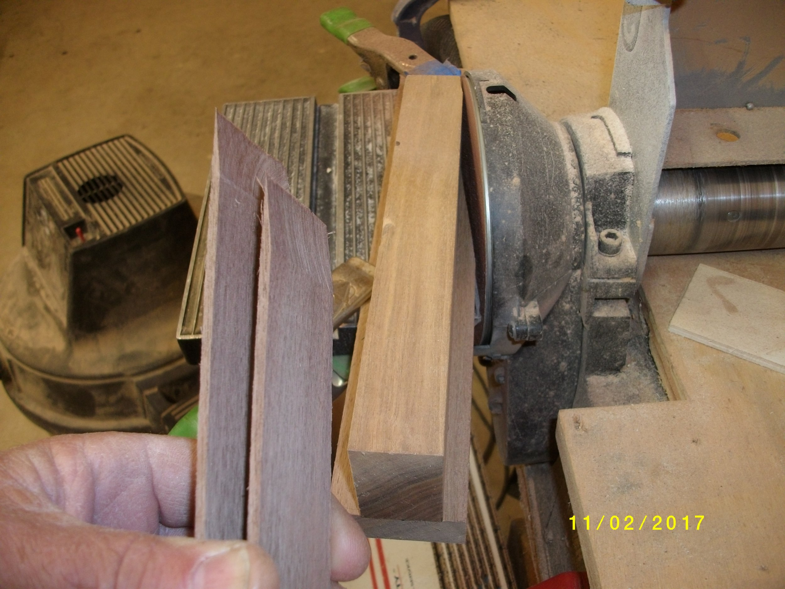 """Now to make 2 - 36"""" lams into a full length one. A simple jig for the disc sander, put the lams together and slide in, it may try to grab it so hold on to them. I grind one with the other backing it, then switch places with them and finish the other one. Try to get them ground squarely so the joint fits nice."""