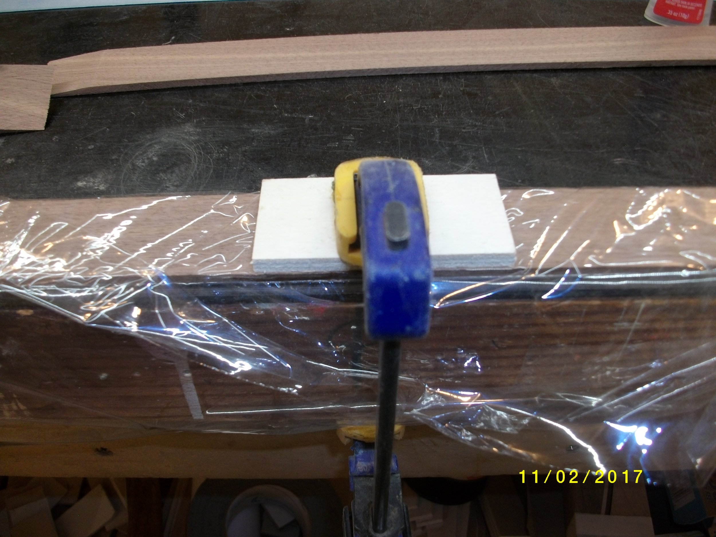 Here it is clamped down. I use Loctite superglue in plastic bottle for these.