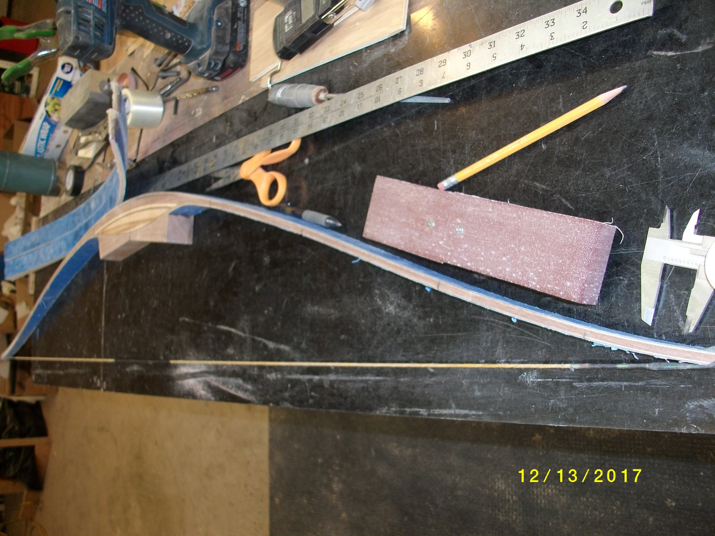 "An inch more reflex changes the bow braced profile a lot, about all I'd want because I don't want the string to hit the limbs.  Note the marks on limb edge, I mark off center , usually at end of fades and each 6"" after that on both limbs, so I can compare measure from sting to see how the limbs are bending in relation to each  other ."