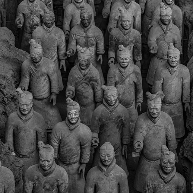 Terracotta Soldiers in Xi'an, China. This excavation site has revealed over 8,000 soldiers (each with a unique face) as well as hundreds of horses and chariots. The army is part of a vast array of hidden chambers surrounding and protecting Emperor Qin Shi Huang's grave. Words and photographs truly cannot do this place justice between the sheer numbers and incredible detail. Scientists are still actively excavating at the location today and are not fully aware what else surrounds the first emperor's tomb. #whereveryouland