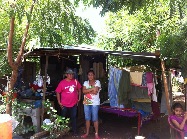 Lady with 3 children living under shed roof in Cristo Rey. We built her a new home.