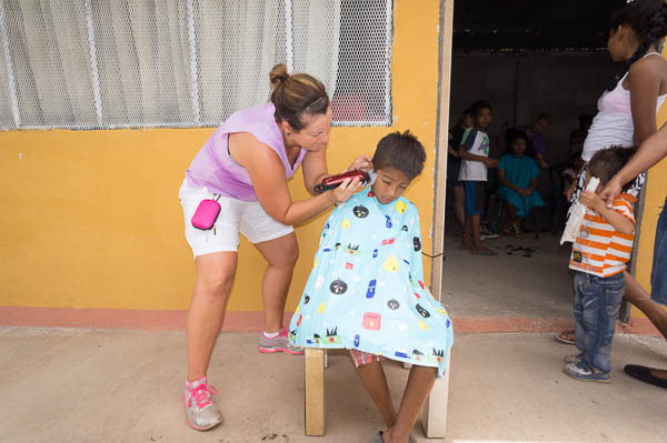 new clothes, shoes and haircuts for children from the dump landfill