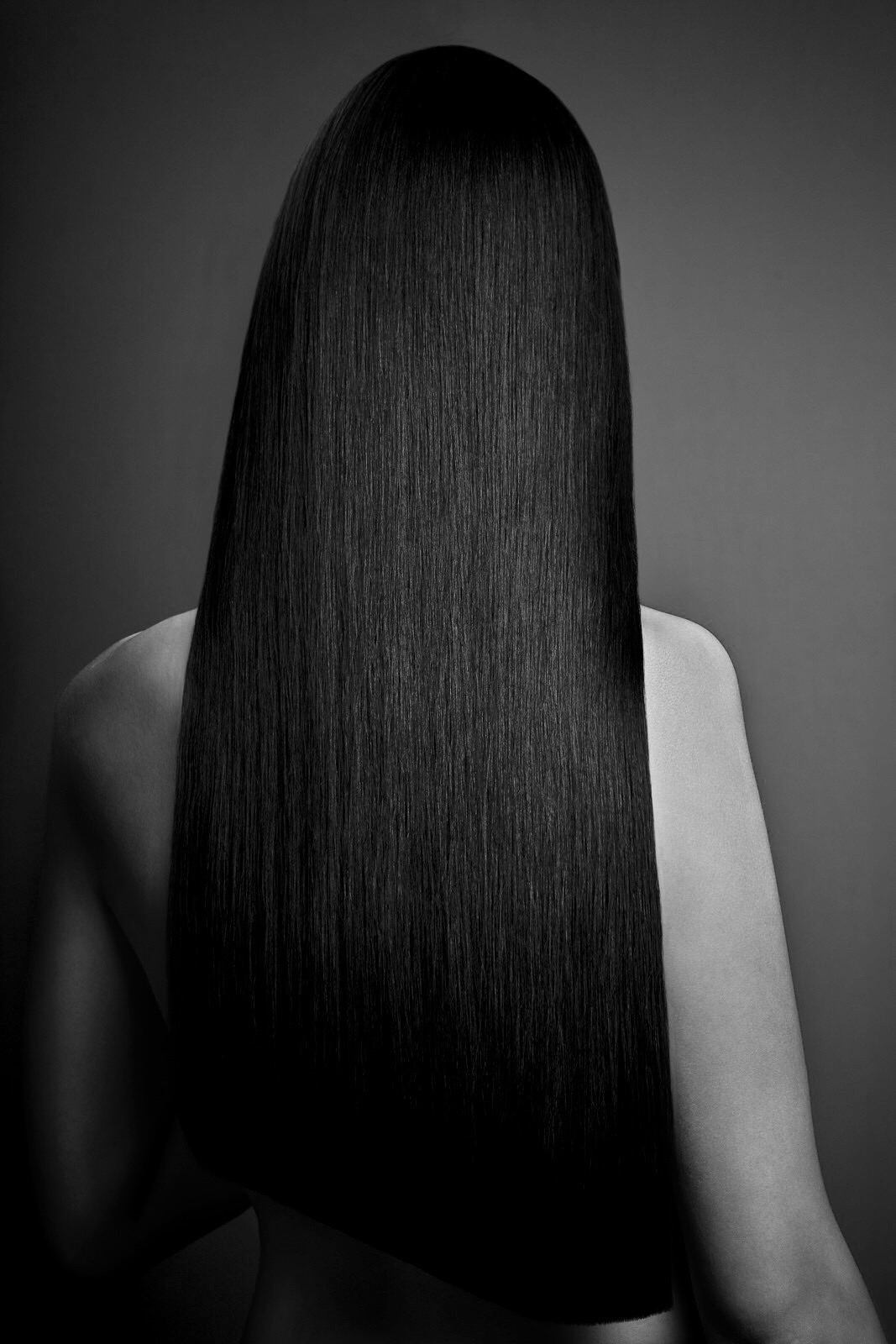 STRAIGHT & SLEEKStraight with a little bit of body. Blowdried straight then, if needed, flat ironed to seal the cuticle with a reparative product. -