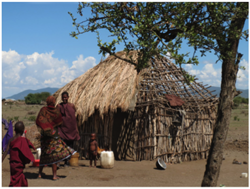 Before moving into her new home, Rose and her three children lived in an exposed hut similar to this one, offering little to no protection against the elements, wild animals, and predators.