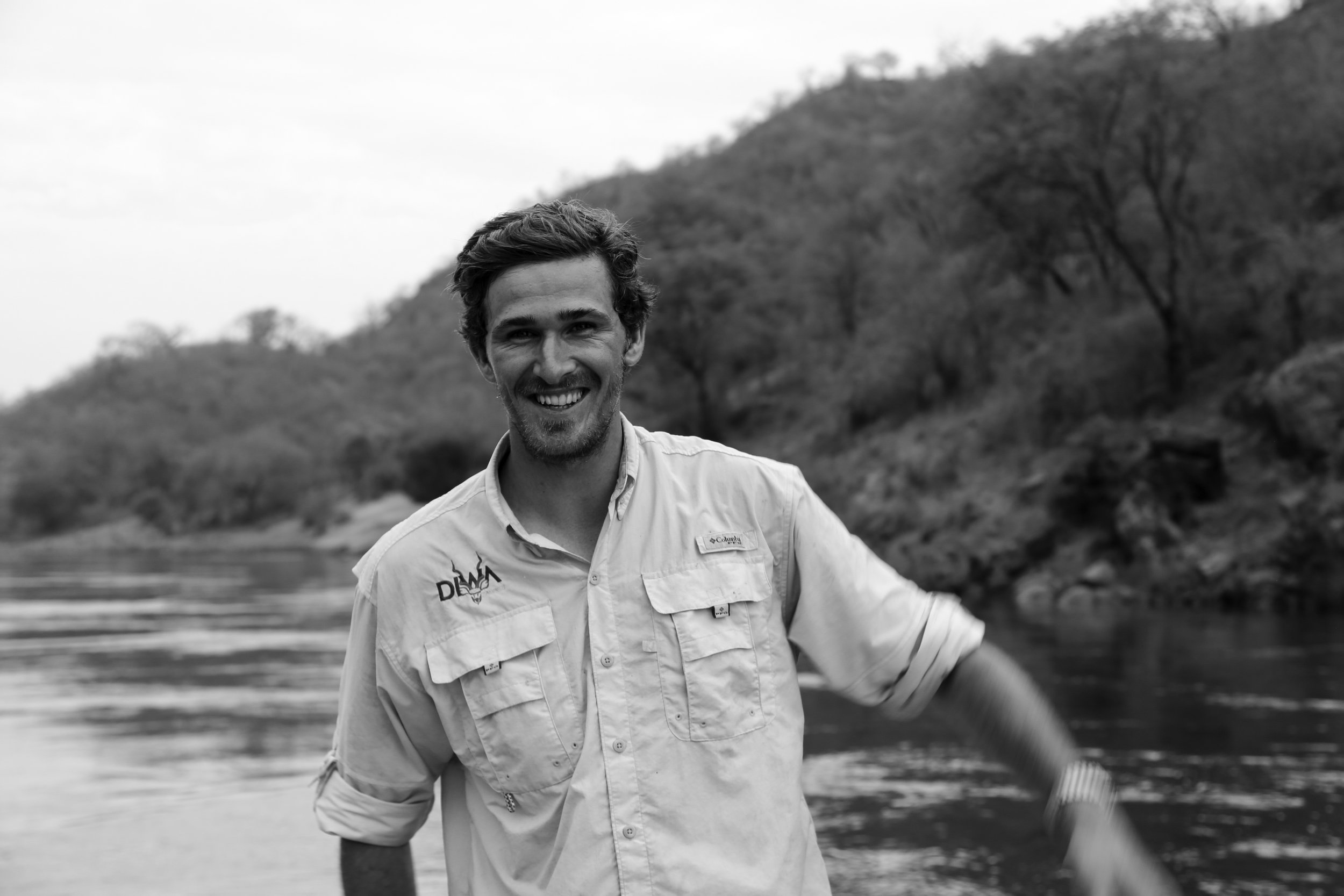 BENJI BLEVIN -  Director and Fundraising  Mechanical engineer, mediator, master angler. We didn't have to search for long to find a good photo of Benji. This smile pervades everything he does and it goes without saying that you're likely to remember fondly, a tour led by him. Benji is also tiger-fishing mad and will lead our efforts to tag and research tigerfish movement patterns and behaviour in the Middle Zambezi.