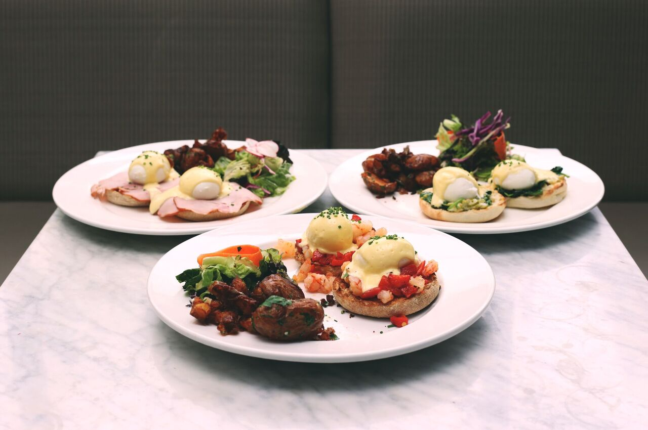 Their amazing $10 benny's selection. L: Original (Canadian back bacon, poached eggs, hollandaise & potato hash) M: West Coast (Rock shrimp & roasted peppers, poached eggs, hollandaise & potato hash) R: Florentine (Creamed spinach & leeks, poached eggs, hollandaise & potato hash)