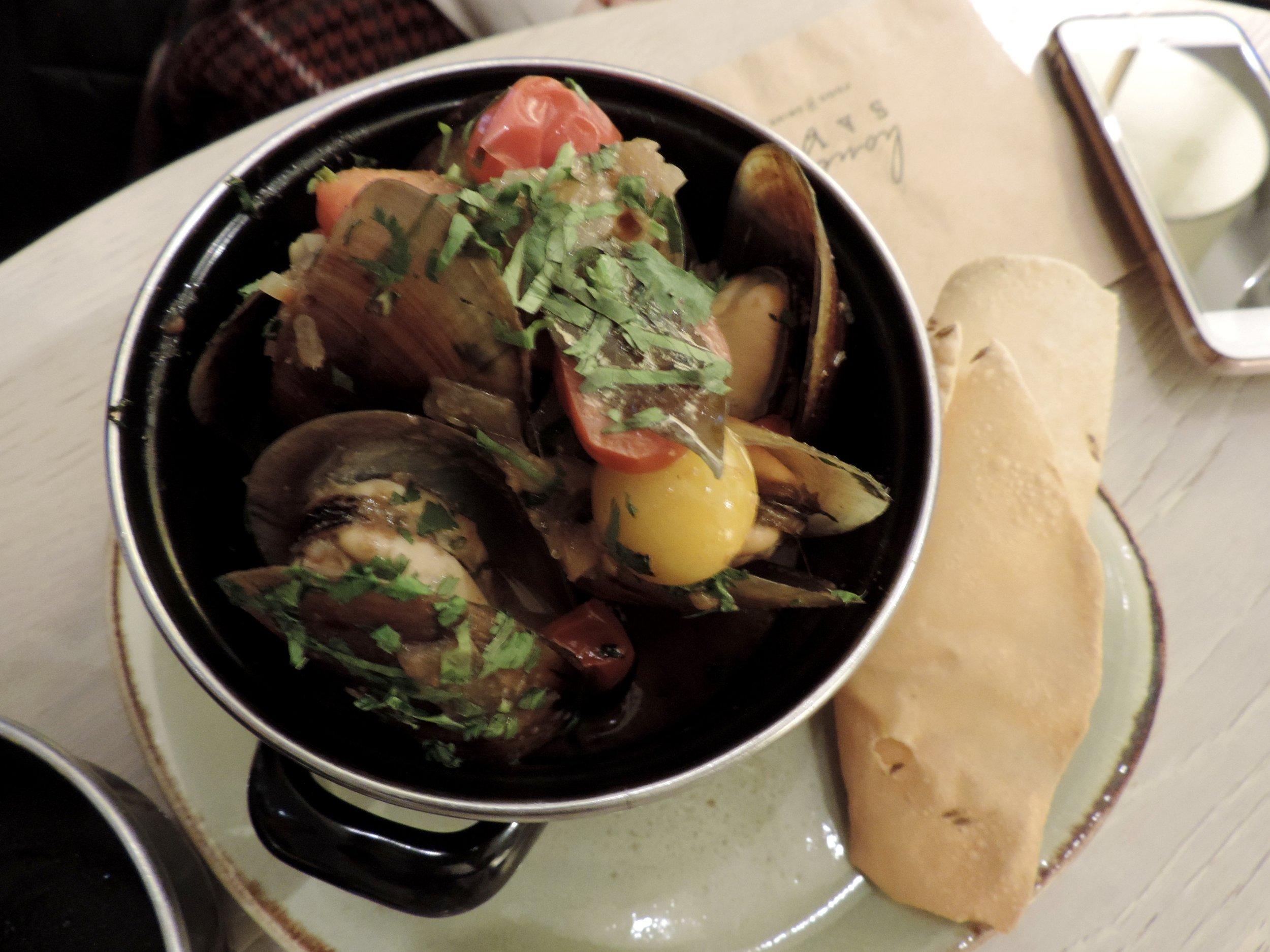 BC Honey Mussels - malabar curry broth, tamarind coconut, cilantro