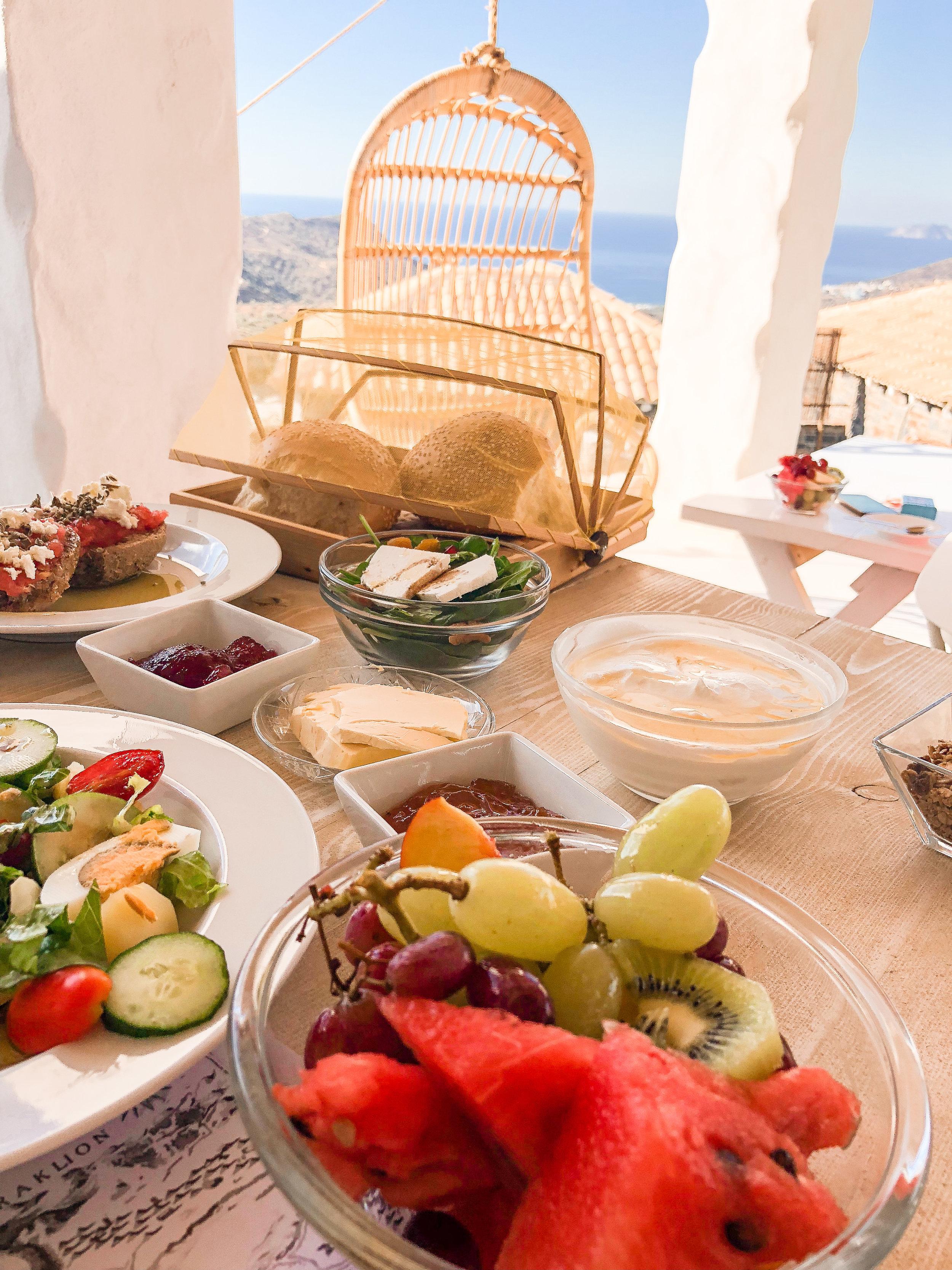 Fresh fruit, locally made greek yogurt and honey, and crusty bread with tomato bruchetta and feta. My dream breakfast!