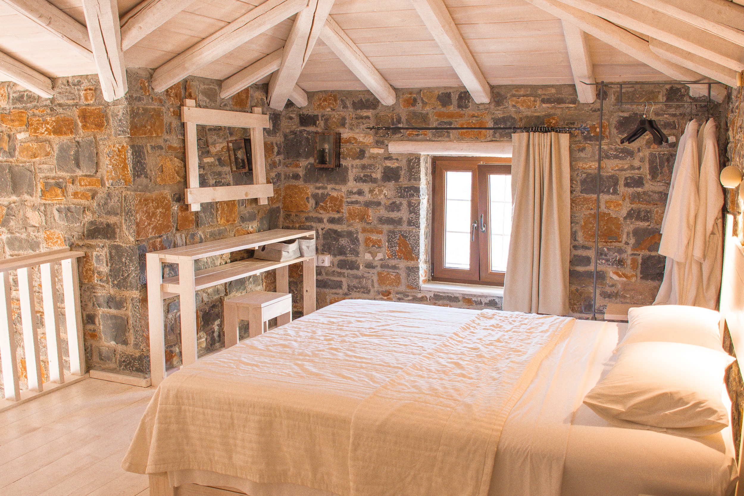 Beautiful bedroom with gorgeous natural light. Crack open the window for a nice little breeze at night.
