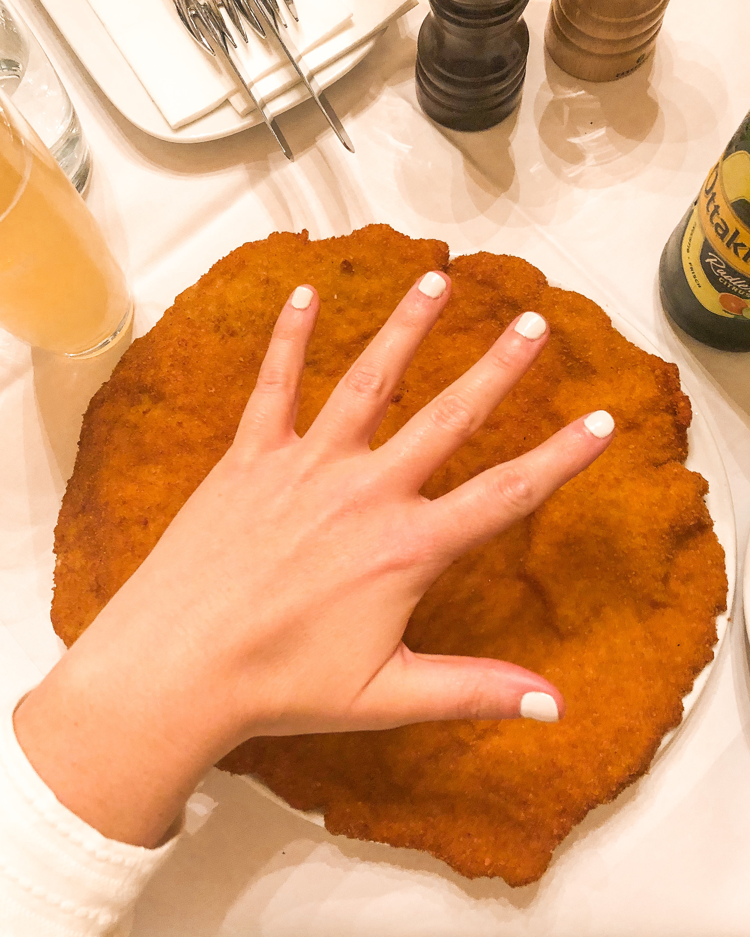 This schnitzel is bigger than my stretched out hand!